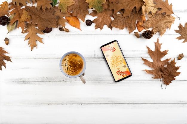 Über ansichtkaffeetasse mit smartphone Kostenlosen PSD