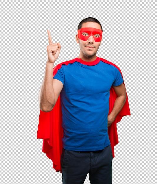 Überraschter superheld, der oben zeigt Premium PSD