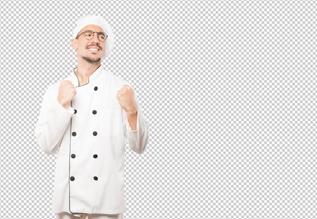 Verärgerter junger koch, der eine wettbewerbsfähige geste tut Premium PSD