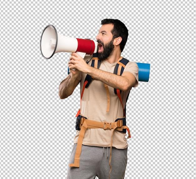 Wanderermann, der durch ein megaphon schreit Premium PSD