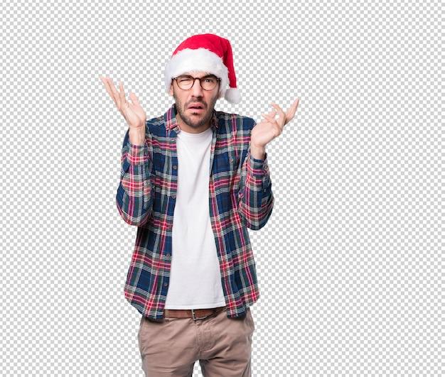 Weihnachtskonzepte - gestikulieren des jungen mannes Premium PSD