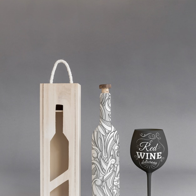 Weinflaschenmodell mit kasten und glas Kostenlosen PSD