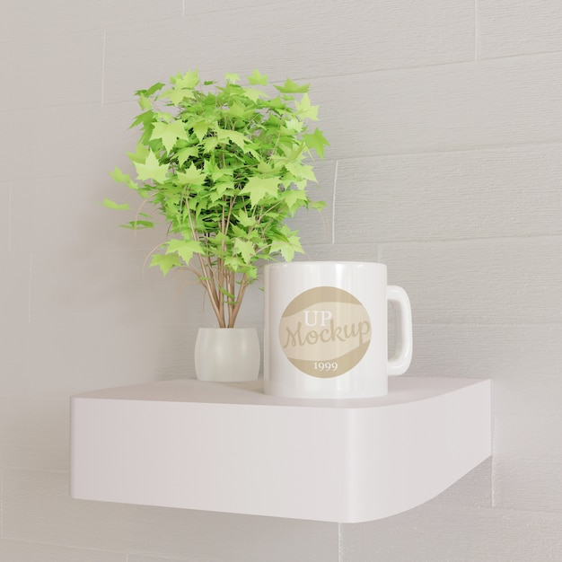 Weißes bechermodell auf weißem wandschreibtisch mit zierpflanze Premium PSD