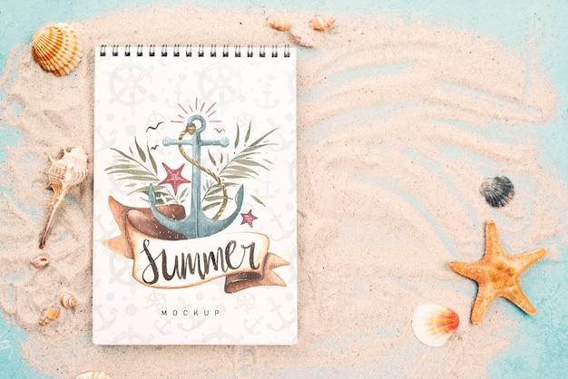 Zitat mit nautischem sommer auf notizbuch Kostenlosen PSD