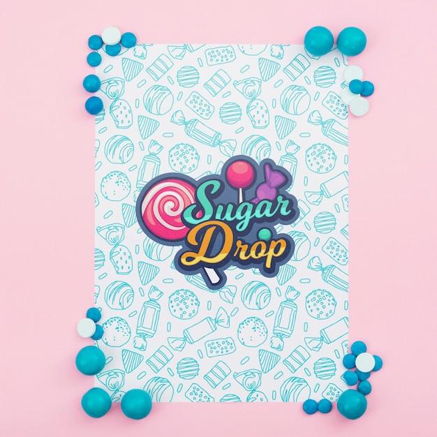 Zuckertropfen-plakatmodell mit blauen süßigkeiten Kostenlosen PSD