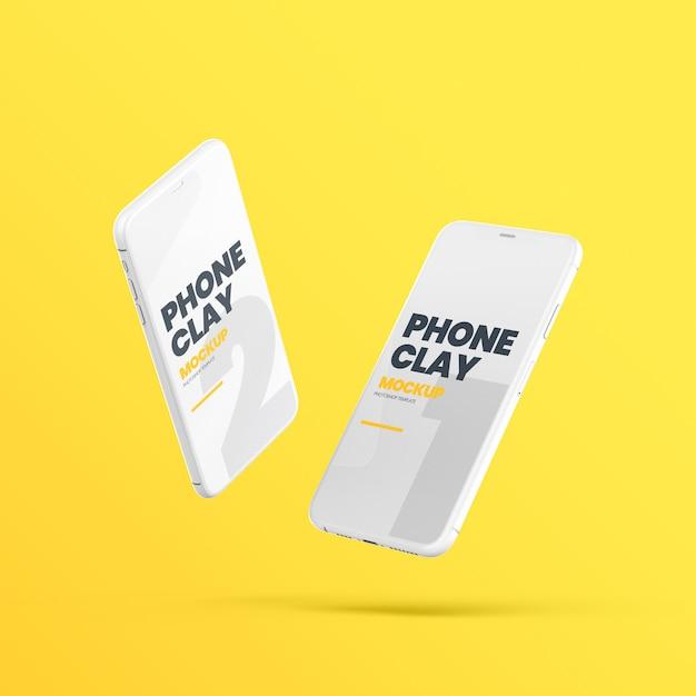 Zwei fliegende clay phone devices mockup Premium PSD