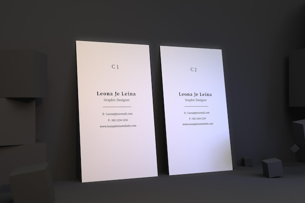 Zwei vertikale visitenkartenmodell mit würfel Premium PSD