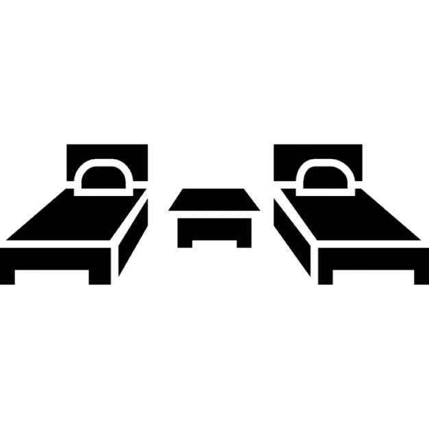 deux lits simples et une petite table au milieu de meubles de chambre coucher t l charger. Black Bedroom Furniture Sets. Home Design Ideas