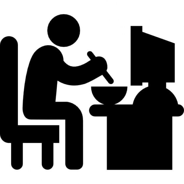 Hombre sentado en su escritorio de trabajo almorzando - Escritorio de trabajo ...