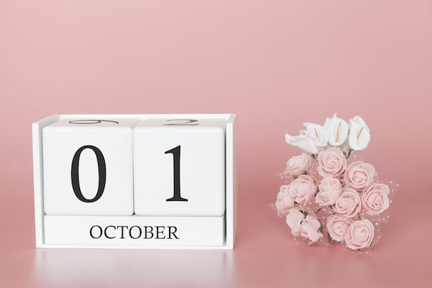 01 octobre cube de calendrier sur fond rose moderne Photo Premium
