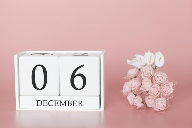 06 décembre. jour 6 du mois. cube de calendrier sur fond rose moderne, concept de commerce et événement important. Photo Premium