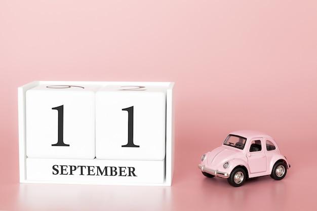 Le 11 septembre. jour 11 du mois. calendrier cube avec voiture Photo Premium