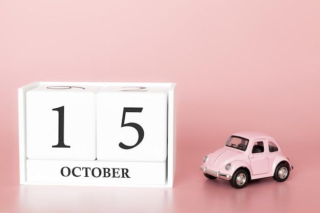 15 octobre. jour 15 du mois. calendrier cube avec voiture Photo Premium