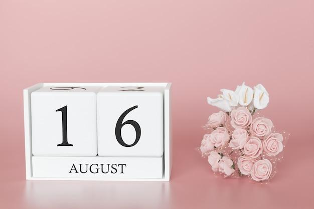 16 août. jour 16 du mois. cube de calendrier sur fond rose moderne, concept de commerce et événement important. Photo Premium