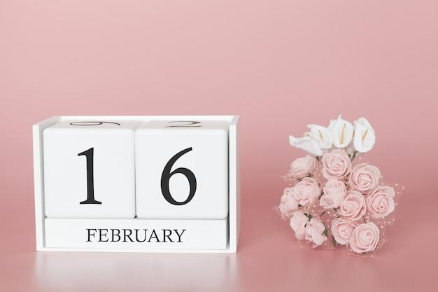 16 février. jour 16 du mois. cube de calendrier sur fond rose moderne, concept de commerce et événement important. Photo Premium