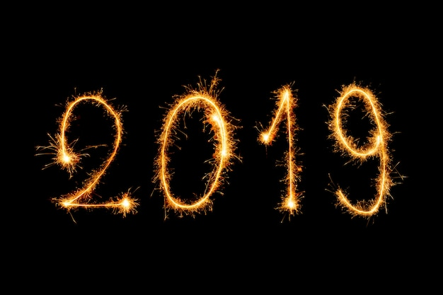 2019 texte de bonne année avec feux d'artifice sparkle isolé sur fond noir Photo Premium