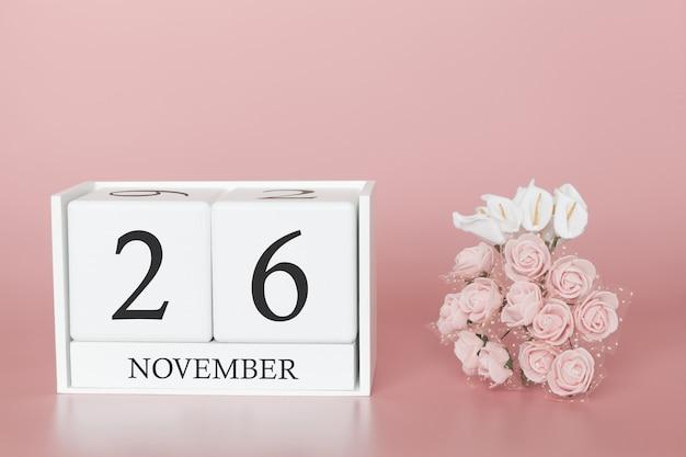 26 novembre cube de calendrier sur mur rose Photo Premium
