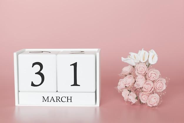 31 mars. jour 31 du mois. cube de calendrier sur rose moderne Photo Premium
