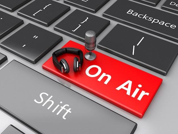 3d word air avec un micro et un casque sur le clavier de l'ordinateur. Photo Premium