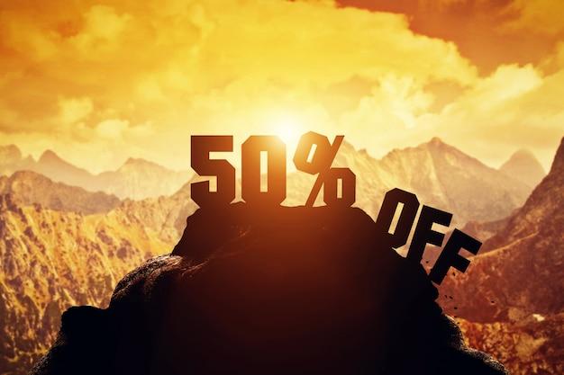 50% de réduction sur l'écriture sur un sommet de montagne. Photo Premium