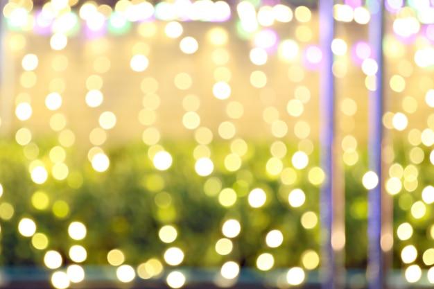 Abstrait bokeh doré et jaune de fond de noël. Photo Premium