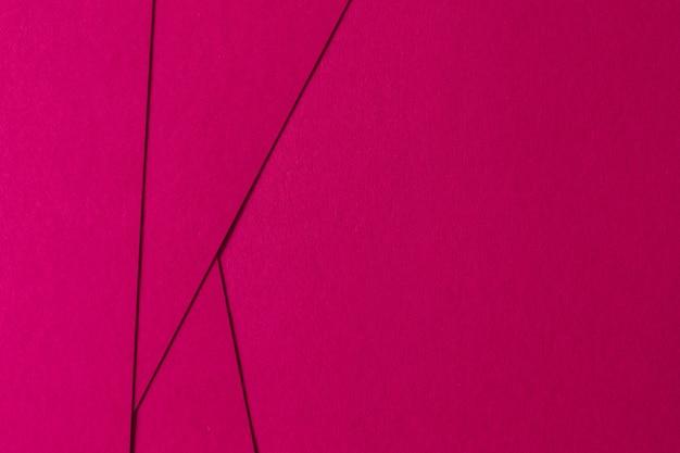 Abstrait de composition géométrique rose avec du carton de texture Photo gratuit