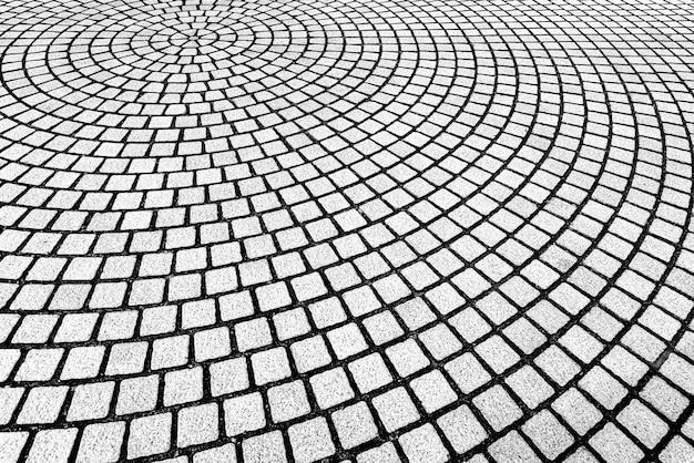 Abstrait du motif de maçonnerie décoré sur le sol en forme de courbe. Photo Premium