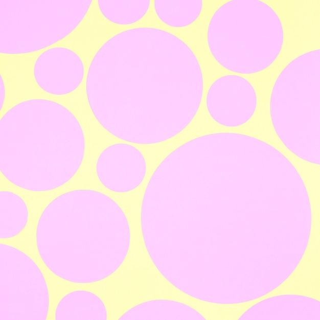 Abstrait Avec Des éléments De Cercle De Papier Rose Sur Fond Jaune Photo gratuit