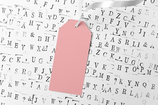 Abstrait avec des lettres noires. étiquette rose vide avec ruban Photo Premium