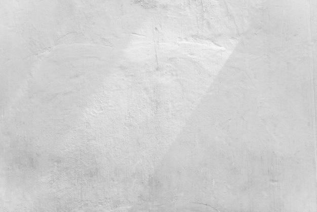 Abstrait de mur de béton blanc avec la lumière du soleil, la lumière et l'ombre. Photo Premium