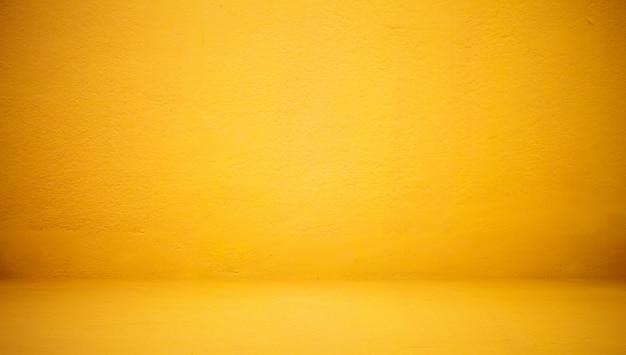 Abstrait le mur de luxe jaune clair sert à la toile de fond, à l'arrière-plan et à la disposition. Photo gratuit