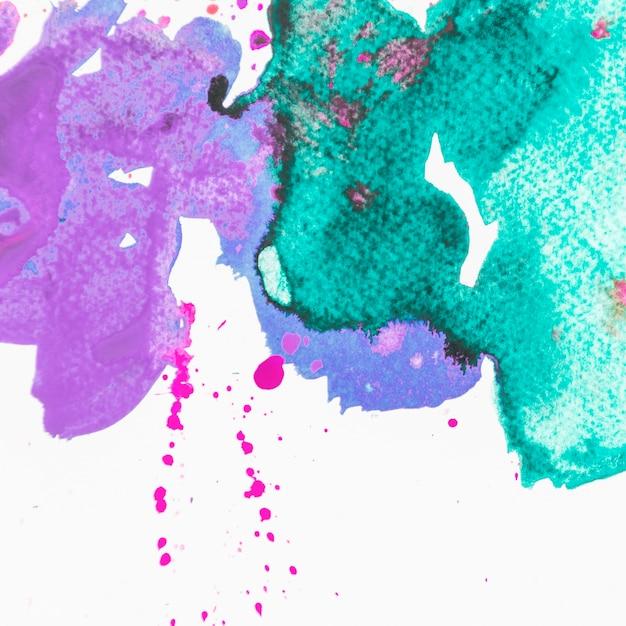 Abstrait peint violet et vert brossé Photo gratuit