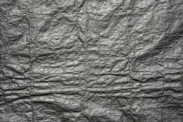Abstrait de texture de sac en plastique noir avec grunge Photo Premium