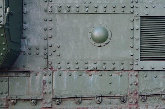 Abstrait vert métal industriel texturé avec rivets et boulons Photo Premium