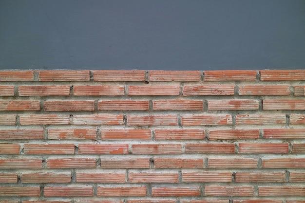 Abstrait, vieille brique avec mur de ciment. Photo Premium