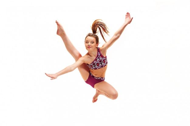 Adolescent Fille Faisant Des Exercices De Gymnastique Sur Blanc Photo gratuit