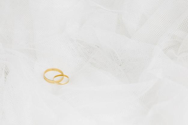 Alliances Avec Voile De Mariée Photo gratuit