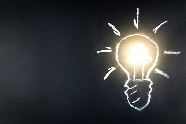Ampoule sur fond noir Photo Premium