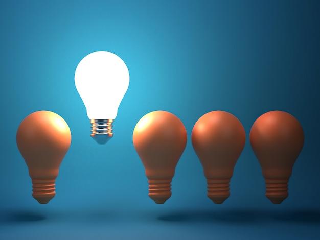 Une ampoule rougeoyante se détachant des ampoules à incandescence non éclairées. individualité et idée créative différente Photo Premium