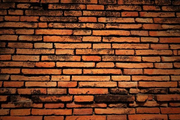Ancien mur de briques rouges. fond d'écran grunge Photo Premium