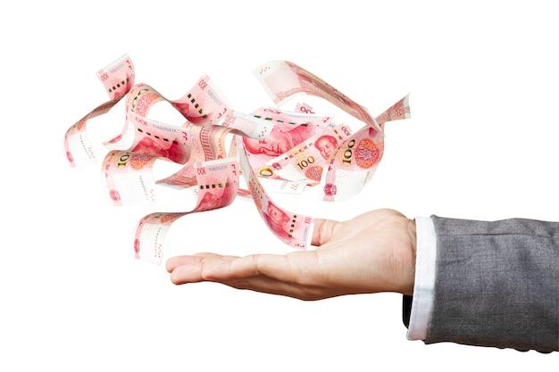 Antigravité de billet de banque en yuan sur la main de l'homme d'affaires Photo Premium