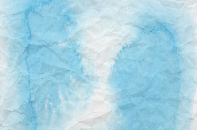 Aquarelle bleue et blanche sur papier froissé Photo Premium
