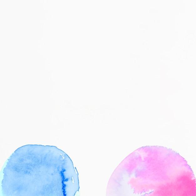 Aquarelle De Demi Cercles Rose Et Bleu Sur Fond Blanc Photo gratuit