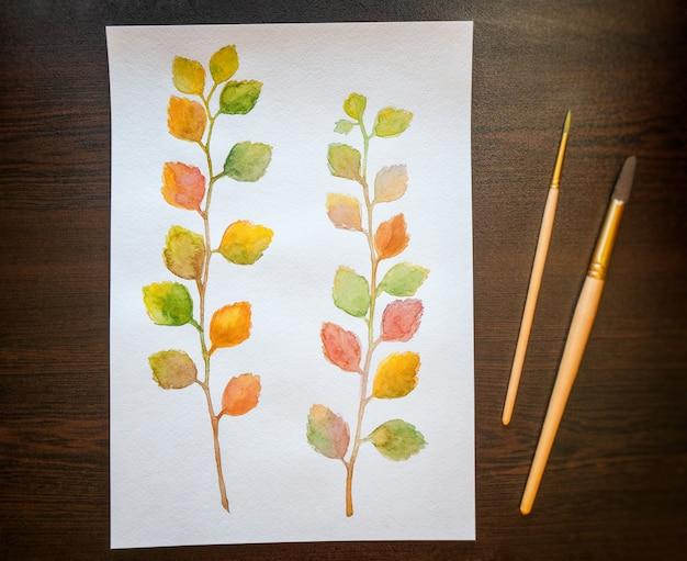 Aquarelle de feuilles d'automne colorés. vue de dessus Photo Premium