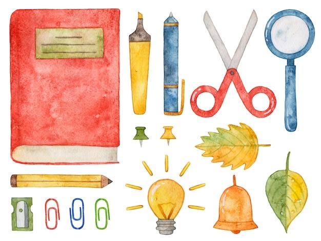 Aquarelle fournitures scolaires. livre, stylo, crayon, ciseaux, loupe. Photo Premium