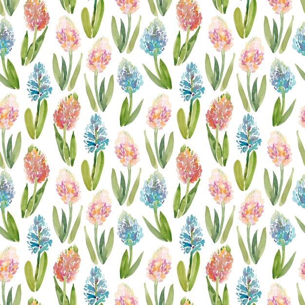 Aquarelle modèle sans couture avec des fleurs de jacinthe sur fond blanc Photo Premium