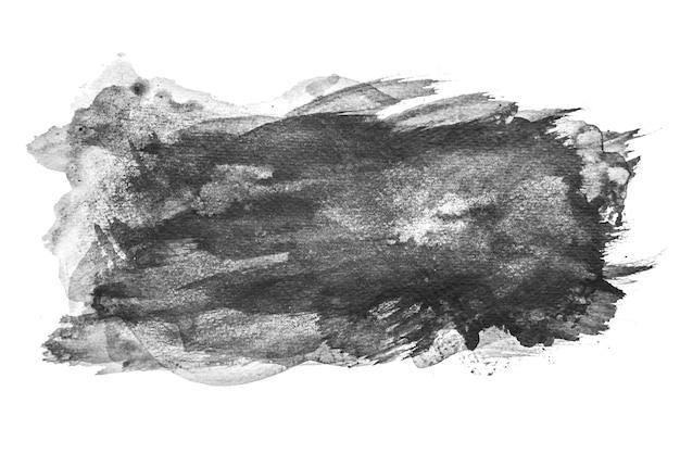 Aquarelle noire éclaboussant sur fond blanc, peinture à la main sur papier. Photo Premium