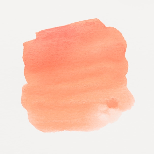Une aquarelle orange tachée sur fond blanc Photo gratuit