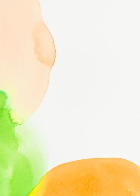 Aquarelle verte et orange sur fond blanc Photo gratuit