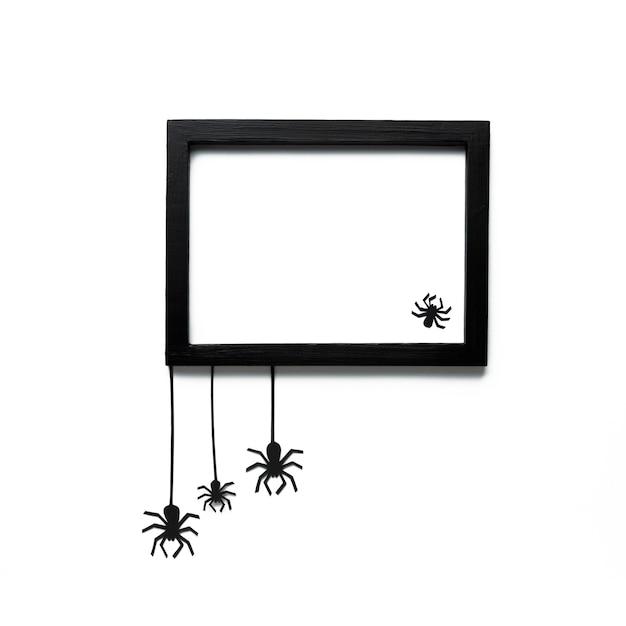 Araignées d'halloween avec cadre de maquette Photo gratuit